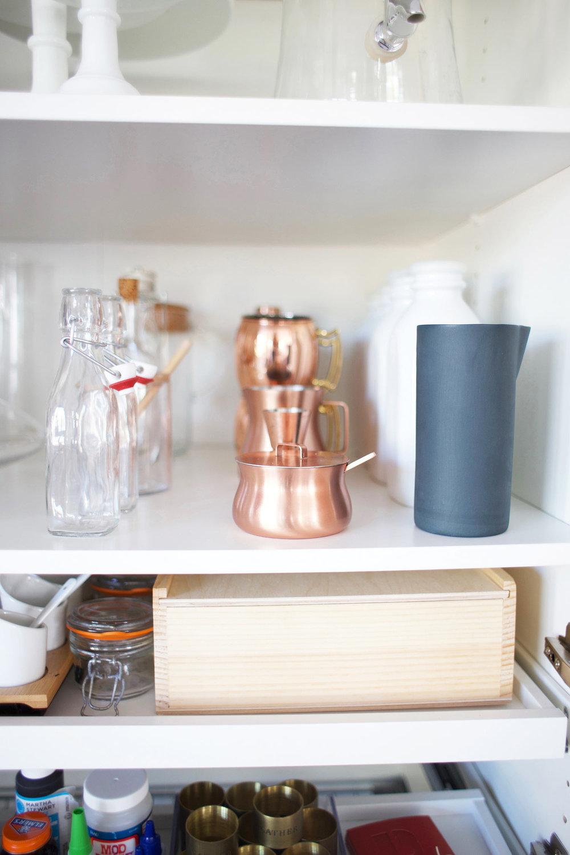 organized blog props on a shelf
