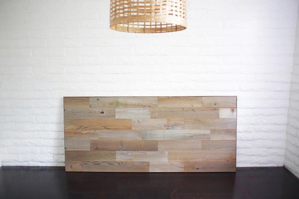 DIY reclaimed wood headboard against wall