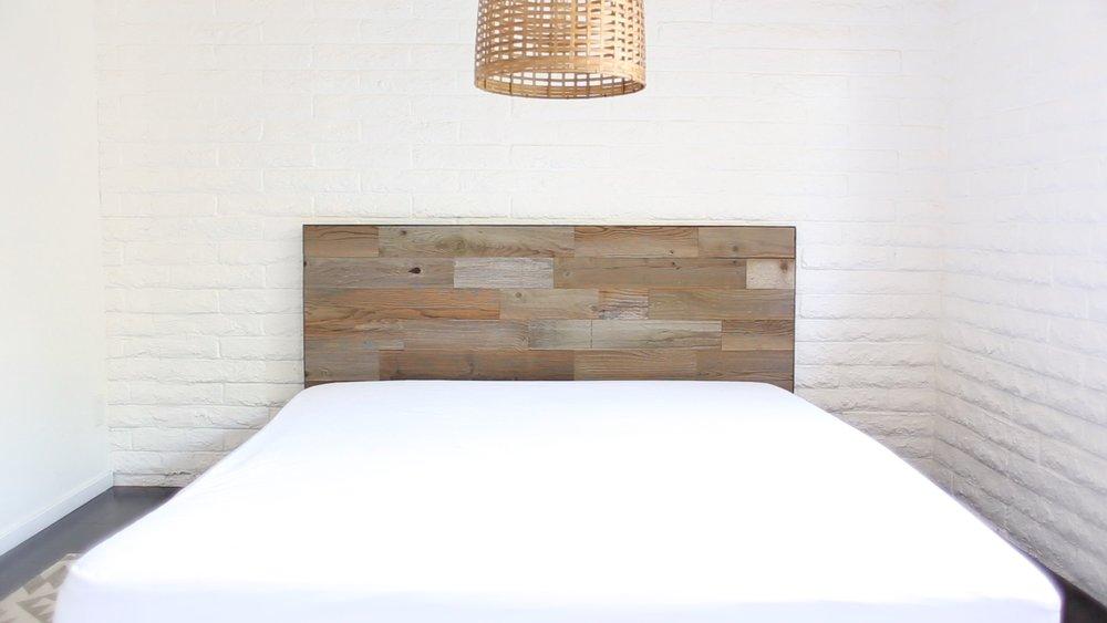 DIY reclaimed wood headboard assembled