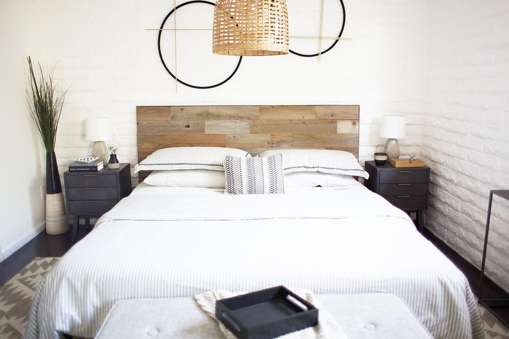 DIY reclaimed wood headboard bedroom makeover after