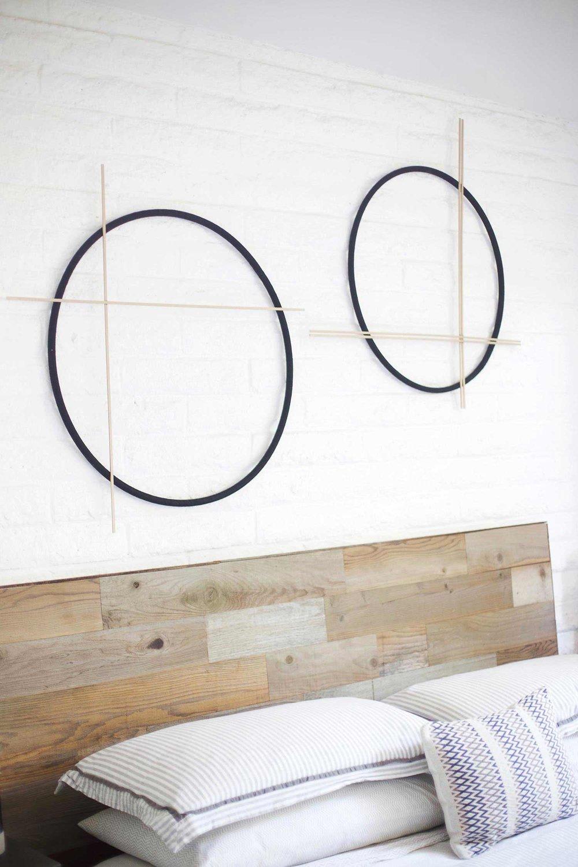 modern black and brass circular wall hanging