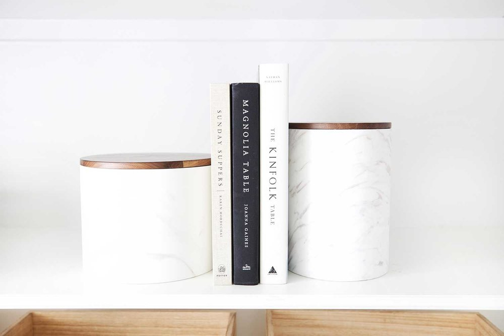 cookbooks and canisters in organized pantry