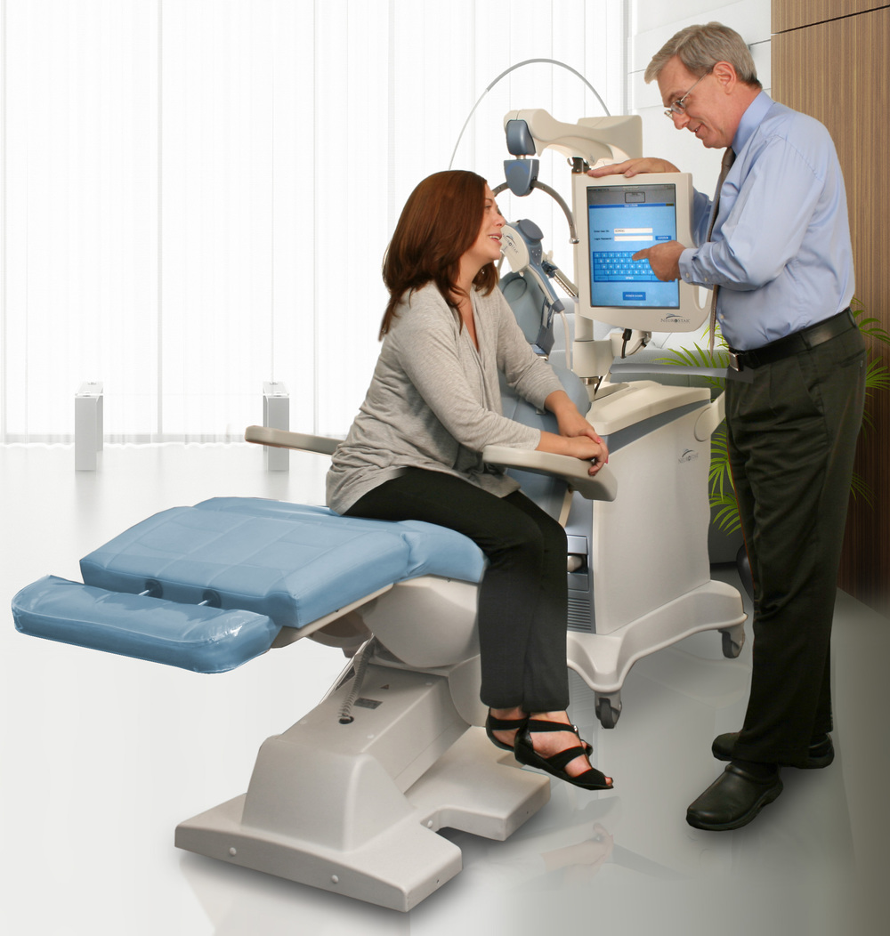 dr and patient sitting on the machine.jpg