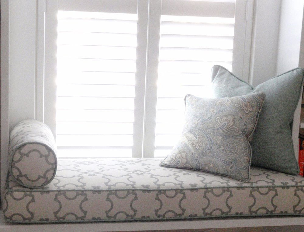 Custom Window Seat Cushion, neck roll pillow and square accent pillows. Custom White Wood Shutters by Hunter Douglas.