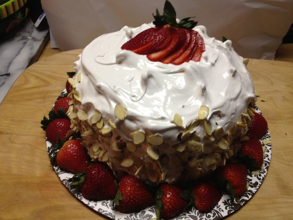 Coconut cake with 7 minute frosting and strawberries
