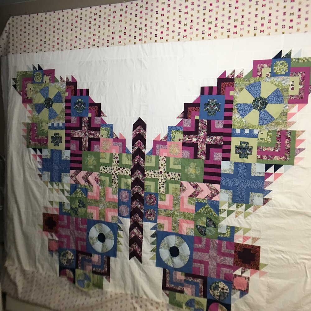 The Butterfly Quilt top is done!!! I added background borders to make it king size. Click on photo for link to Tula Pink's Butterfly Pattern