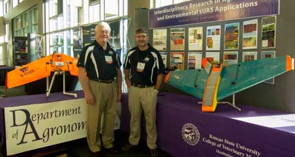 Kansas State University researchers Kevin Price (left) and Deon van der Merwe pose next to two of their small unmanned aircraft systems (UAS). The pair is part of a larger team that has been working on agricultural applications for UAS for the past two years. Photo courtesy of Kevin Price.