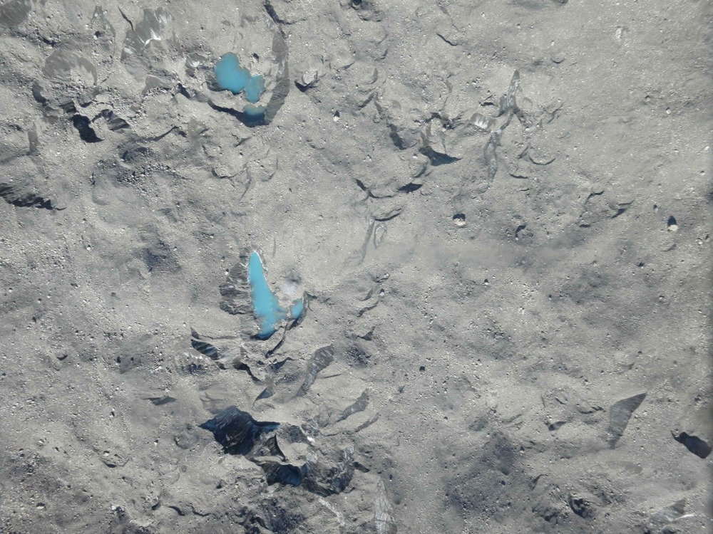 One of the 1,655 images of Tasman Glacier that we've taken from the Sky Hunter. The glacier is covered in debris, hence its gray color. Blue melt ponds are on the surface.