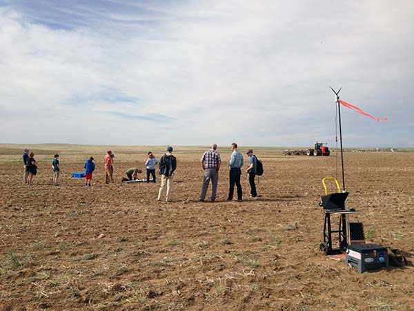 The Agribotix team wanders a recently plowed field. Dryland organic farming requires a delicate balance of management decisions, which can be educated by UAV-collected images.