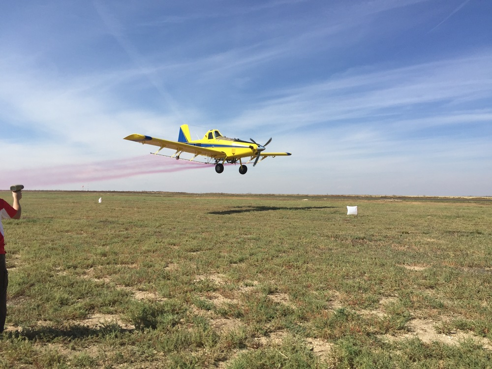 An Air Tractor spraying colored water in a demonstration. The drone visibility tests were done at 250ft AGL.