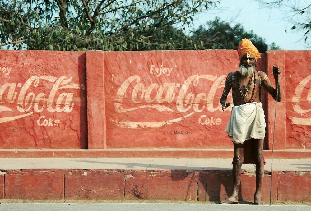 A Saddhu in Agra, India standing near the world famous Red Fort. Circa Feb 2000 on 35 mm film