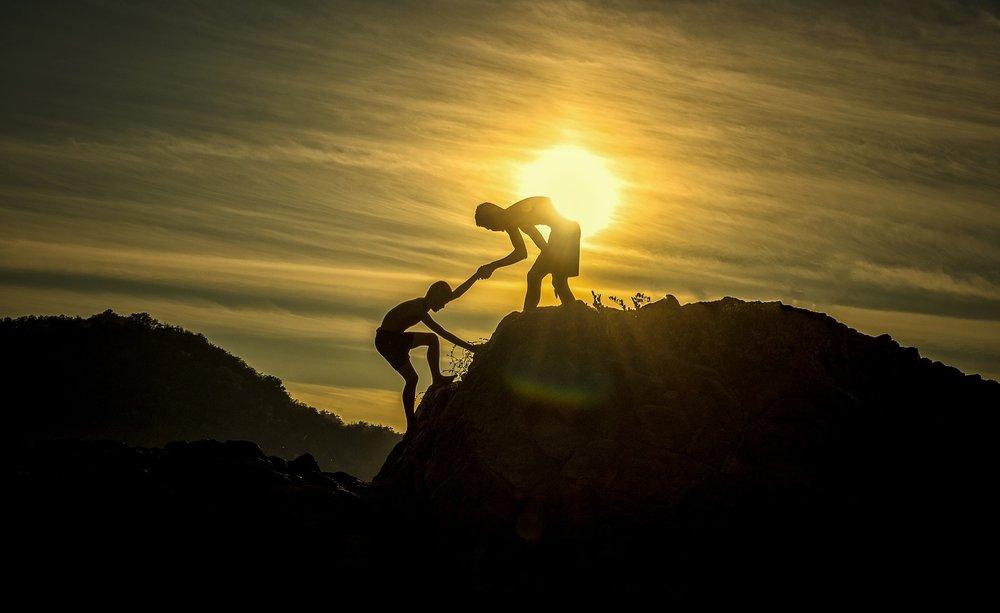 climbing with help.jpg
