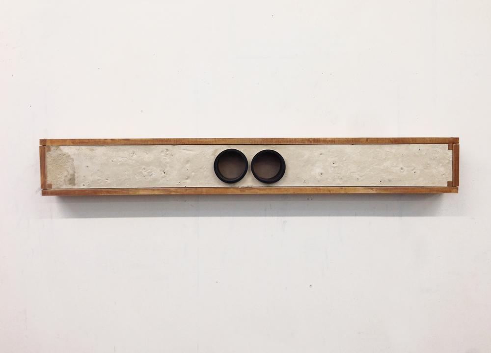 "Soo Shin\ Waited\ wood, concrete, rubber tubes\ h5"" w50"" d5""\ 2012"