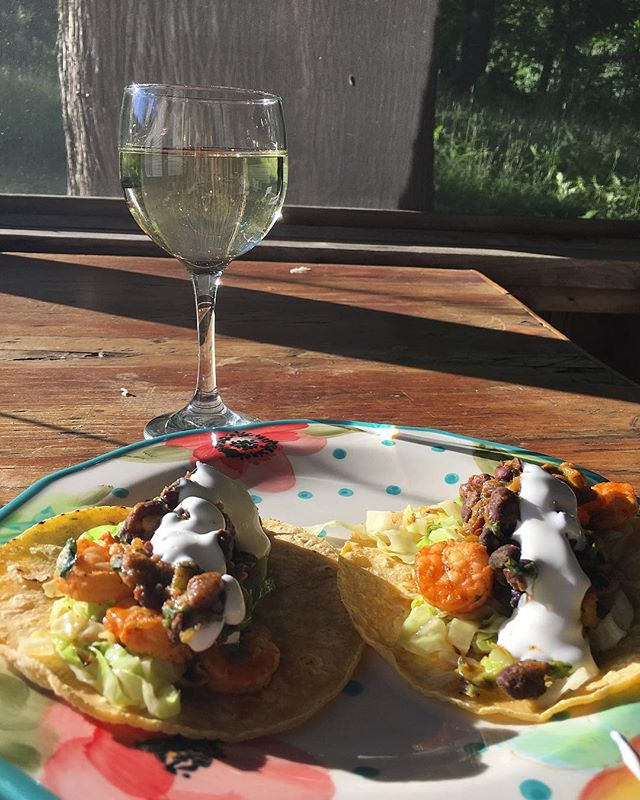 Supper! Cilantro lime shrimp tacos 🌮 with slightly sautéed cabbage, and green chilis and black beans. #illtake4more #sauvignonblanc #ontheporch #summerinmaine