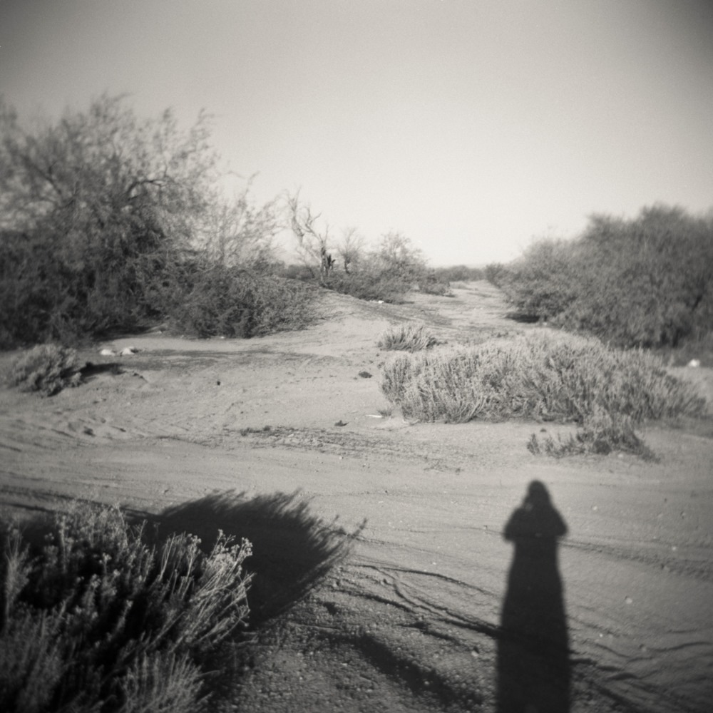 05/11 – Self Portrait with Desert   Gelatin Silver Print on Ilford Warmtone Fiber Paper © 2014, Gina DeGideo
