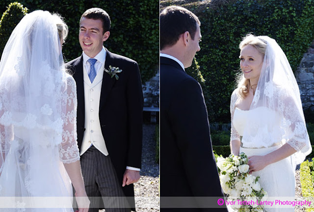 Bride and groom relax in a secluded garden on their wedding day