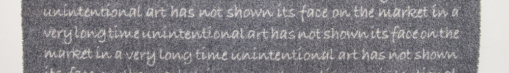 Writing of wall carpet which you could read only in the mirror at Sotheby's Vienna exhibition space.