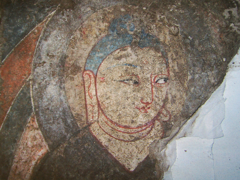 Mural depeciting Buddha also referred to as Mona Lisa of the Western Regions (a part, at the Xinjiang Archaeological Institute) Photo by. Y Kojima
