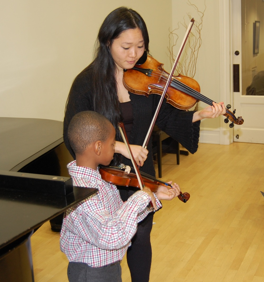 Violin student and teacher duet performance.JPG