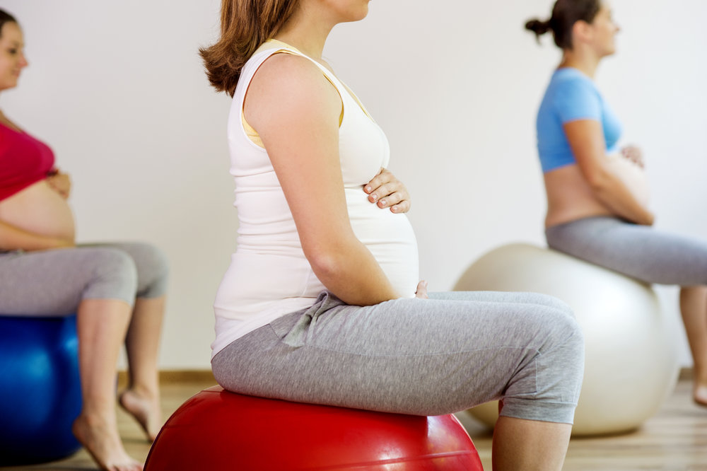 graphicstock-young-pregnant-women-doing-exercise-using-a-fitness-ball_rRx8Jls2Wb.jpg