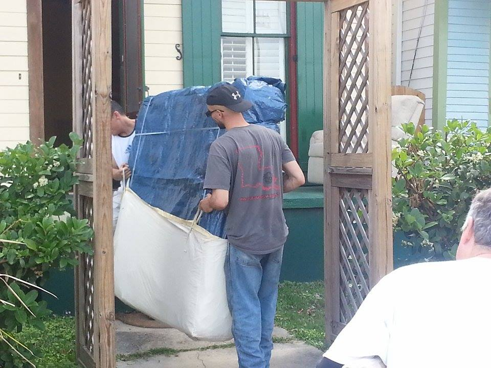 Paul and George move in a mattress using our mattress sling.