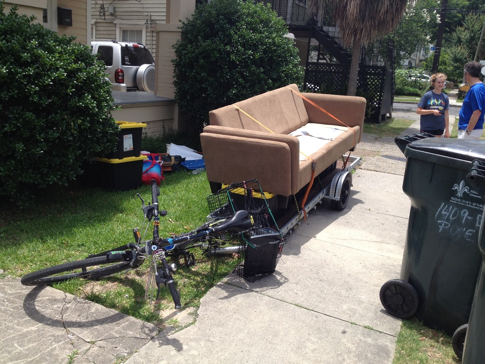 After being lowered down with ropes the couch is loaded and ready to go.