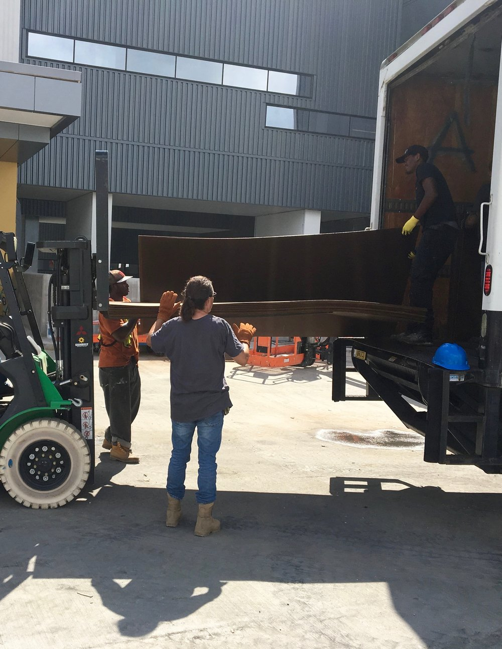 Unloading Masonite