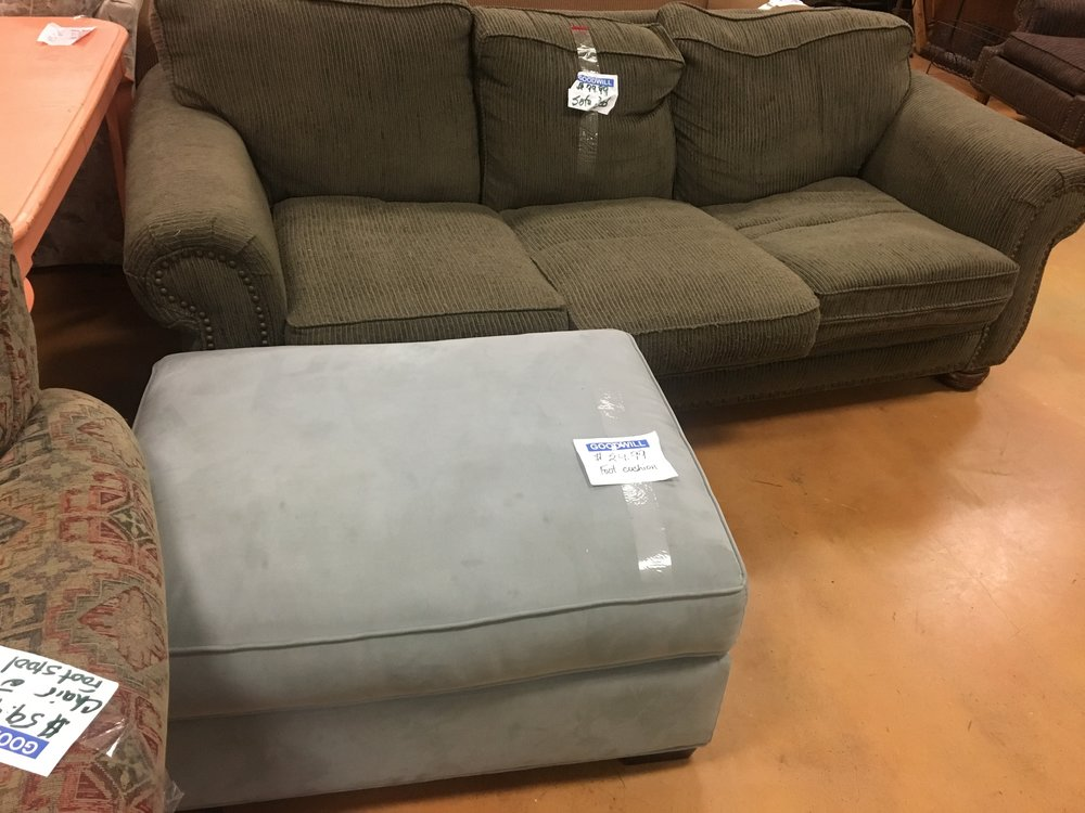 Ottoman at Goodwill with sofa sleeper in background that was delivered by MOVE IT! by bike earlier