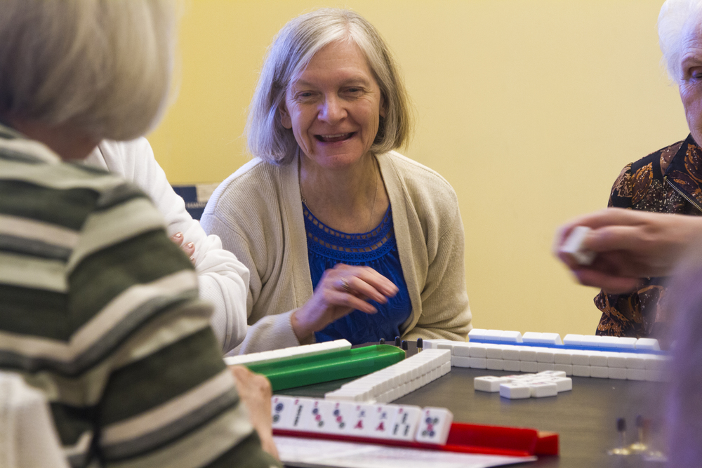At 10a.m. of Sept. 24, 2014, Molly Heller, who voluntarily teaches Mahjong, a traditional Chinese board game, at the Centre Region Senior Center located at State College, Pa., on regular basis, was instructing four senior members how to play.