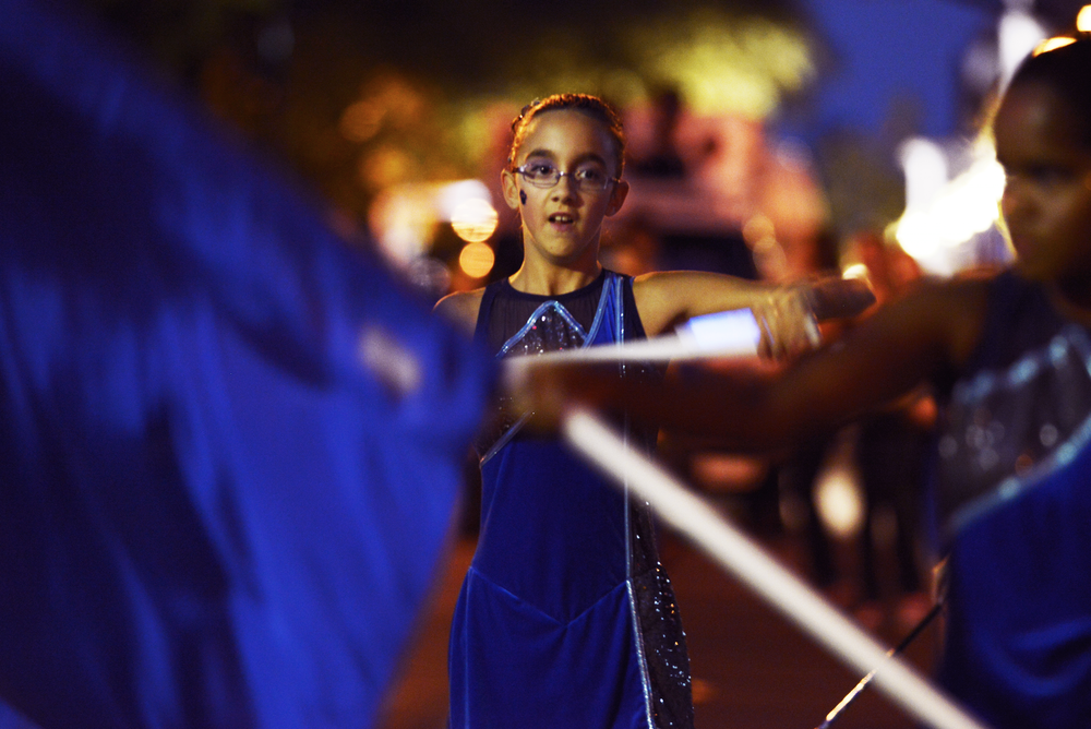 A young female dancer march in the 2014 Penn State Homecoming Parade during festivities Friday night in State College.