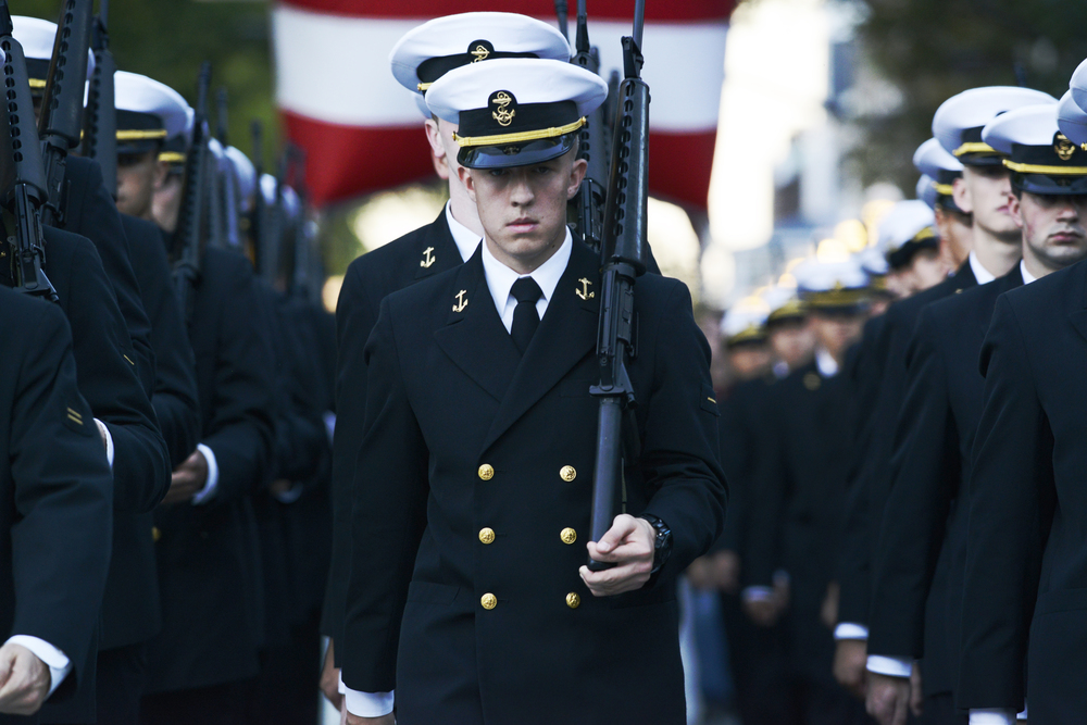 Penn State NROTC students march in the 2014 Penn State Homecoming Parade during festivities Friday night in State College.