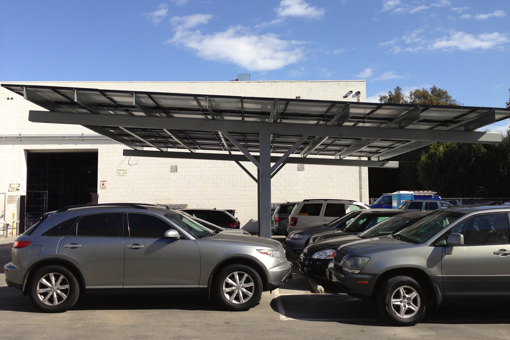 The photovoltaic carport collects solar energy and shades the cars below.