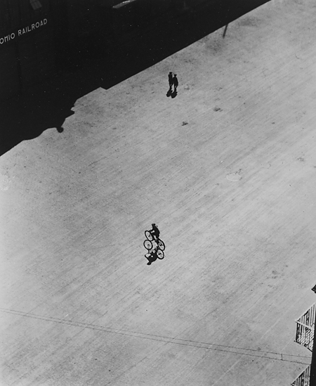 Boy on Bike Below Brooklyn Bridge