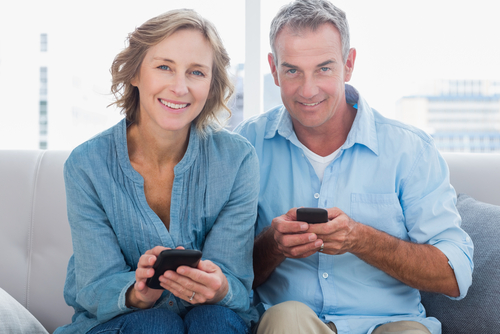 happy couple using phones.jpg