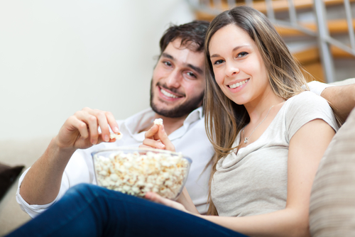 young couple eating popcorn.jpg