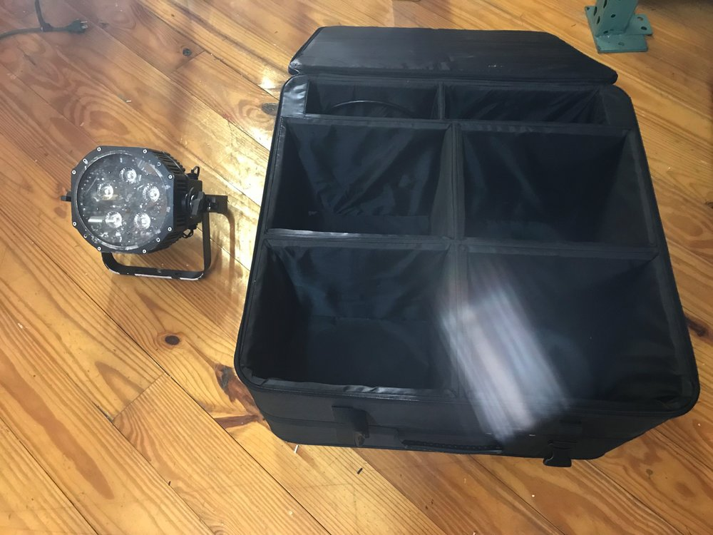 Here we have a rental light and the case.  You will get 4 of these lights ready to throw in the back of an SUV, and GO Red!