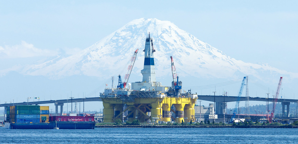 Shell Oil's controversial Arctic oil drilling rig, the Polar Pioneer, parked in the port of Seattle. Behind it is Mt. Rainier.