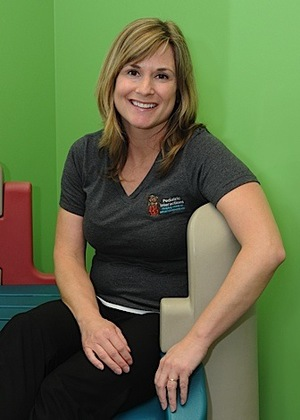 Jill White,M.S., CCC-SLP/L - Jill began her career at Indiana University and received her master's degree at the University ofLouisiana. She has over 20 years of experience with a wide range of clients in a variety of settingsincluding schools, hospitals, nursing homes, in-patient and out-patient rehabilitation centers and private practice. Jill believes strongly in the benefits of early intervention and incorporating functional communication strategies into daily routines. She enjoys working primarily with the birth-to-three population. While Jill has participated in a variety of continuing education opportunities, she has taken special interest in learning more about the Masgutova Neurosensorimotor Reflex Integration (MNRI) method, Prompts for Restructuring Oral Muscular Phonetic Targets (PROMPT), autism, oral-motor and feeding disorders. She enjoys developing and leading a variety of groups at the clinic such as the caregiver- toddler music classes and early childhood/social language preschool groups. Jill enjoys spending her personal time with family, being outdoors, and supporting local causes by running 5K and half marathons (after completing the Chicago Marathon). Now that Jill's two sons are older, she is hoping to spend some more time traveling. Jill has gained personal experience caring for an adult-family member with Down syndrome.Currently, Jill is the speech/language pathologist/leader of the Monkey Group and Music and Signing Class.