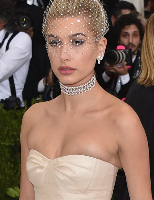 Hailey Baldwin  | wearing Carolina Herrera and Lorraine Schwartz diamond choker and earrings