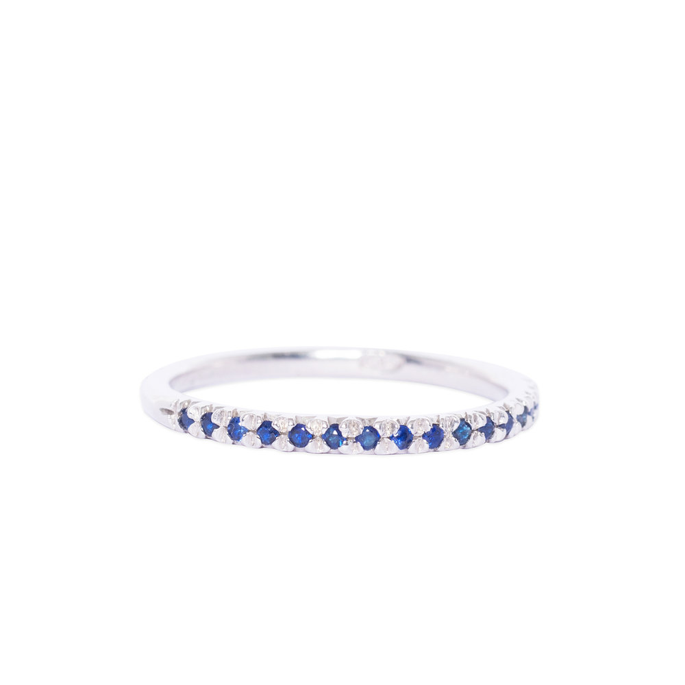 Silver and blue sapphire half eternity ring