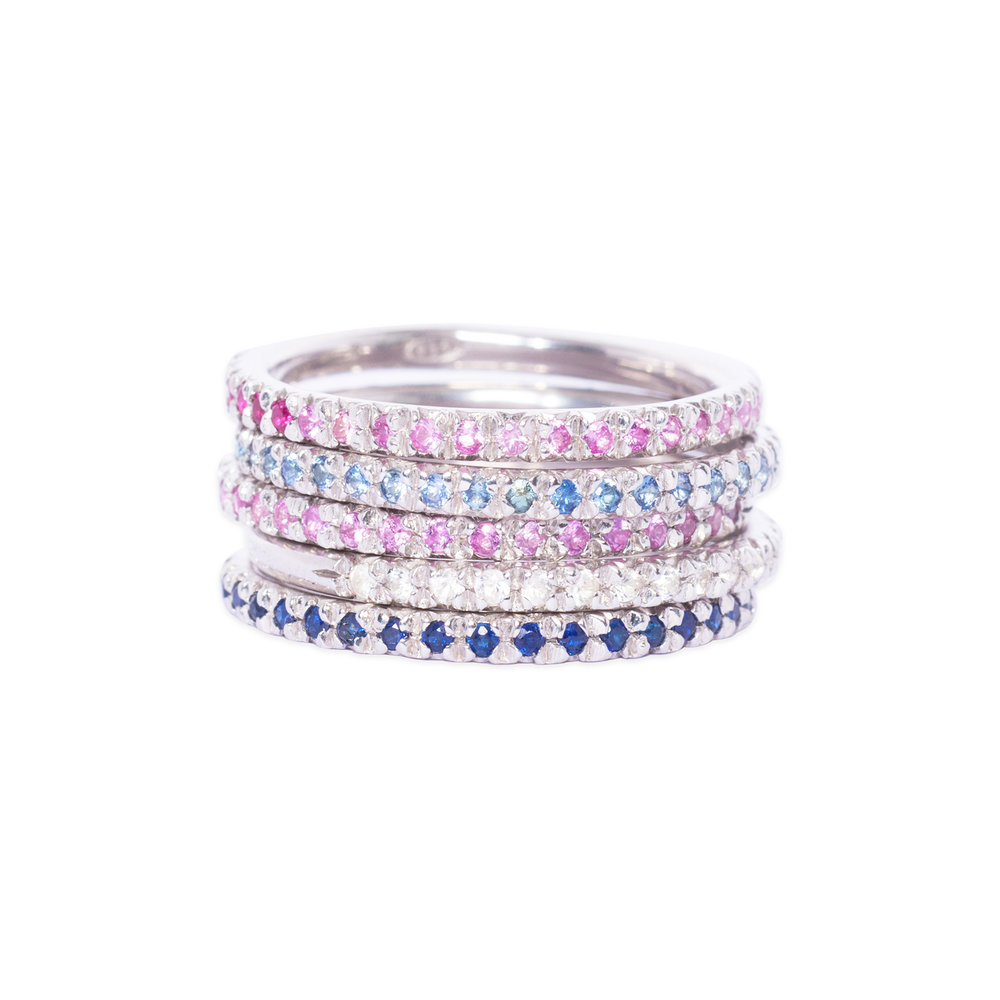 Silver and sapphire eternity rings