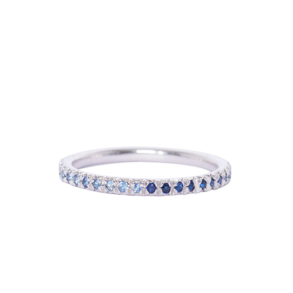 Silver and blue sapphire eternity ring