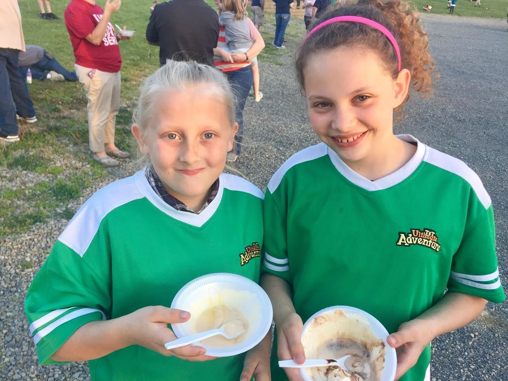 Ariel Jones (left) and Chloie Raber (right) enjoyed ice cream with toppings at the 100-foot banana split on Wednesday night at the Chili Crossroads Bible Church. The AWANA awards ceremony celebrated the accomplishments of the many children in the community who memorized hundreds of Bible verses this year. See more pictures at  www.facebook.com/ChiliChurch . The church's summer youth program starts May 24 every Wednesday at 6:30pm. Bible study for teens and adults. Everyone welcome.