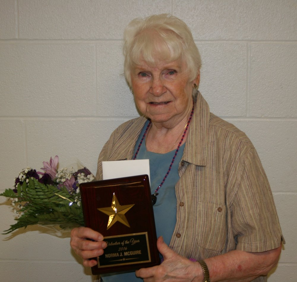 Volunteer of the Year award to Norma Jean McGuire of Dennison
