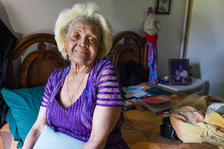 Esther Ellis sits on her bed at home in Hawthorne, Calif., on July 18, 2017. She received a new mattress earlier this year from Partners in Care, a nonprofit that runs four of the dozens of sites in California's Multipurpose Senior Services Program, a Medicaid-funded home services program. (Heidi de Marco/KHN)