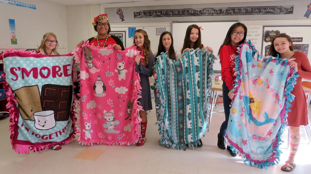 As one of their service projects for this school year, NMS Student Council members and their advisors made tie blankets, that were donated to Akron Children's Hospital.