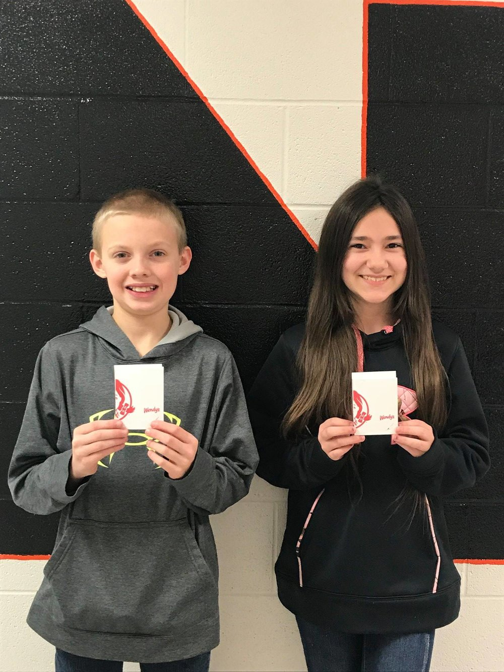 They were the winners of Wendy's Gift Cards after their names were drawn from 6th-grade students who had Perfect Attendance for the second 9 Weeks.