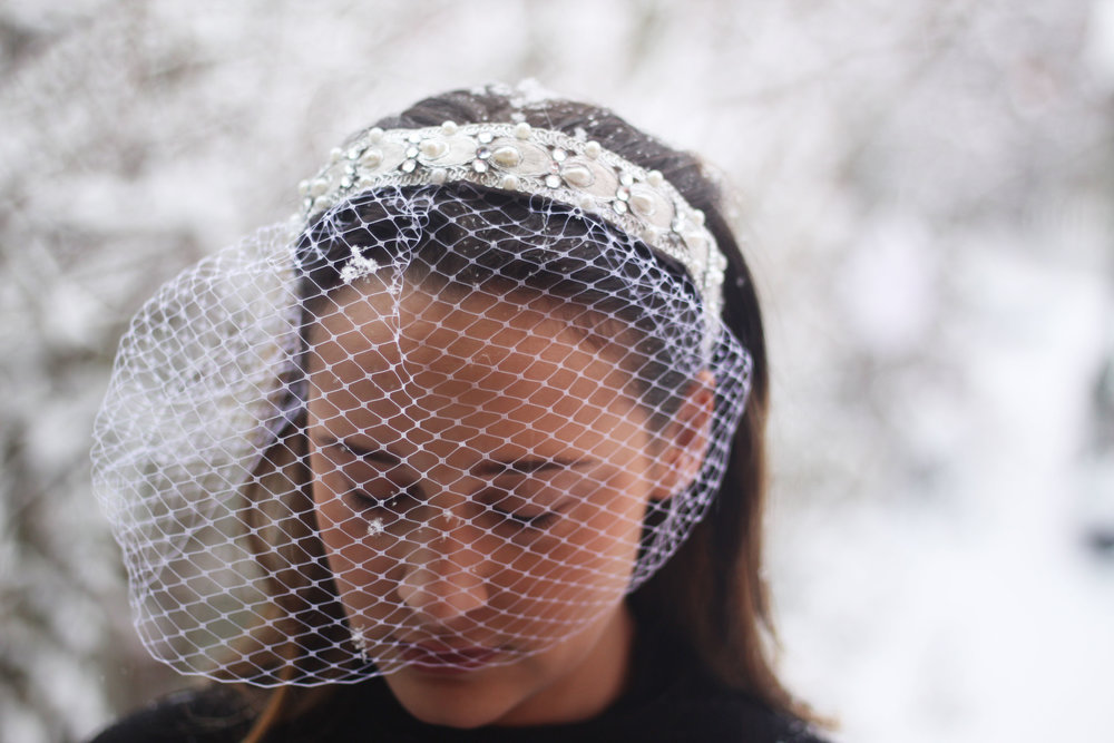 Silver and white bejeweled headband with mini veil