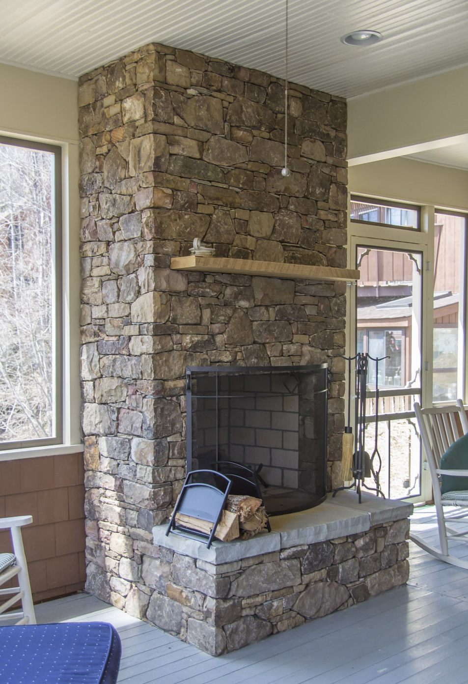 New stone fireplace in screened porch