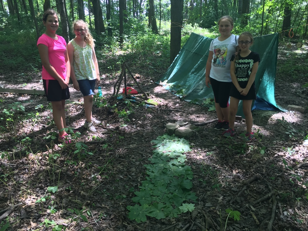 Girl vs Wild built their shelters and decorated them!